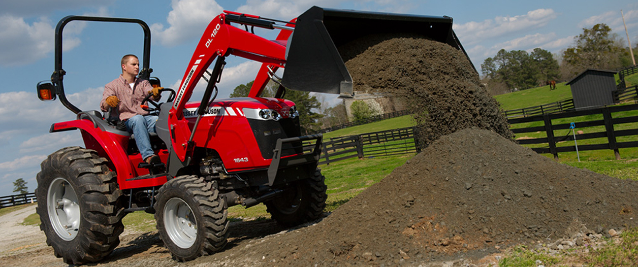 Massey Ferguson tractor with bucket attachment